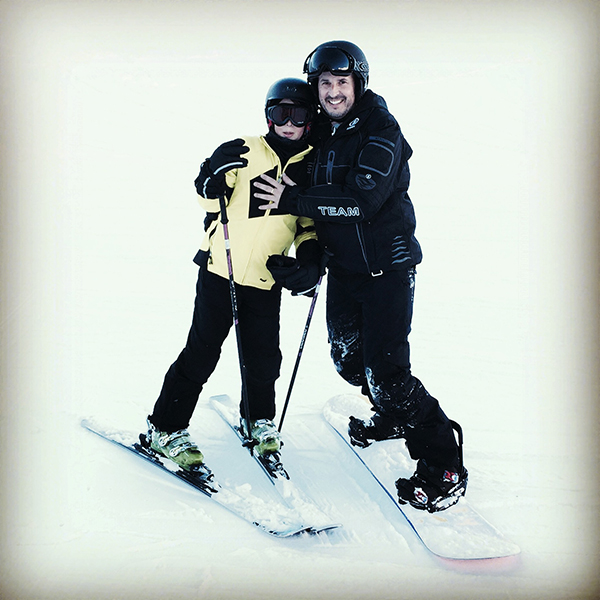 Omri skiing with his son
